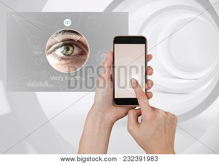 Digital composite of Hand Touching Mobile Phone and Identity eye Verify App Interface
