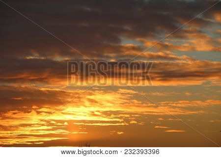 Dawn Over The City. The Sky With Fluffy Clouds At Dawn. Sunrise Over Houses.