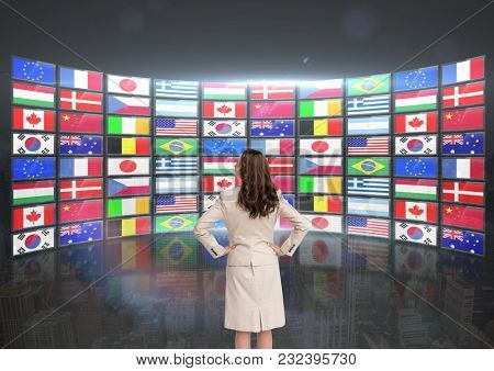 Digital composite of panel with flags (bigger one) . Woman with his hands on the waist looking the screens