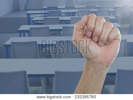 Digital composite of Hand in fist in classroom