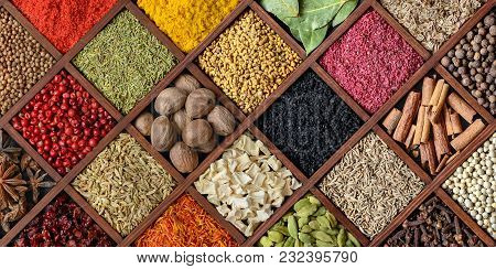 Spice And Seasoning Background Top View. Assortment Of Spices And Herbs In Wooden Box With Many Comp
