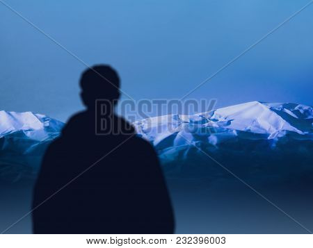 Silhouette Traveler Man Looks At Mountain Range. Sportsman Mountaineer Before Climbing. Concept Acti