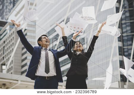 Business People Are Throwing Up Papers, While Standing In Front Of Office Building. Business Success