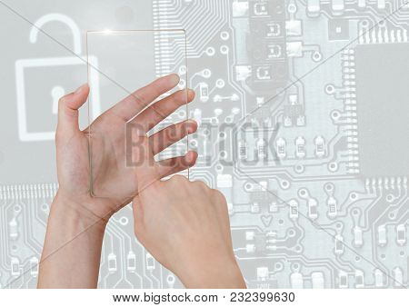 Digital composite of Hand holding glass screen over security circuit board interface
