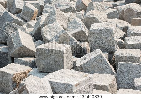Pile Of Hard Stone Blocks Of Cubic Form Or Shape And Gray Color