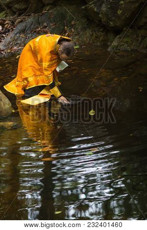 KOH CHANG, THAILAND - MAR 9, 2018: Orthodox priest during sacrament of spiritual birth - Baptism. There are currently 10 Orthodox parishes in Thailand, Orthodoxy is practiced by 0.002% of population.