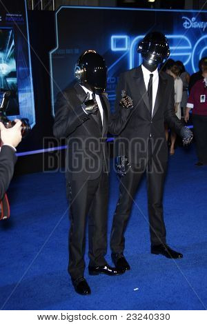 LOS ANGELES - DEC 11: Daft Punk at the world premiere of 'Tron' held at the El Capitan Theatre in Los Angeles, California on December 11, 2010