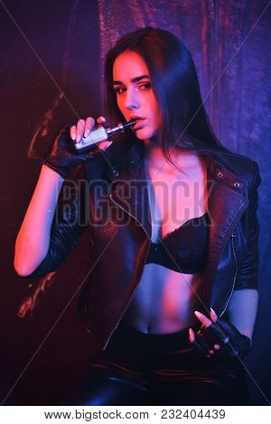 Sexy Girl Smoking Electronic Cigarette, Vape Mod Concept. Sexually Girl Is Vaping. The Model Vaper V