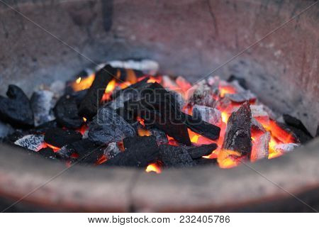 A Small Live Piece Of Coal In A Dying Fire. Fireplace, Embers Of Coal.