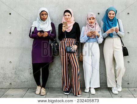 Islamic group of women using smartphones