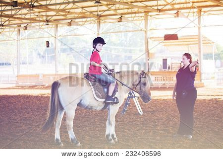 Ber Yakov, Israel - September 21, 2016: Horse Riding Lessons For Kids. The Boy On The Horse