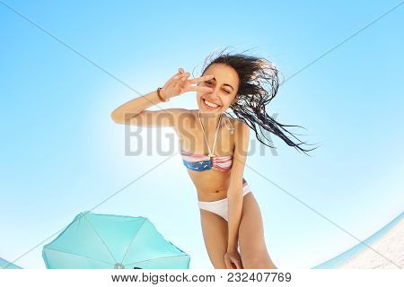 Beautiful Smiling Woman Looks Inside The Tent And Shows Victory Sign In Camera . View From Inside Te