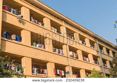 Facade Of Apartment And Dormitory Sun Drying Hanging Clothes Line  In Vietnam