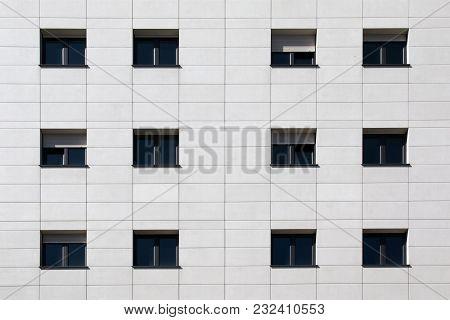 Black Windows On White Flagstone Building Facade