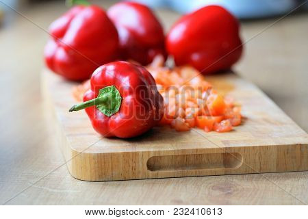 Pieces Of Paprika And Red Pepper On A Cutting Board. Gourmet Food In The Kitchen.