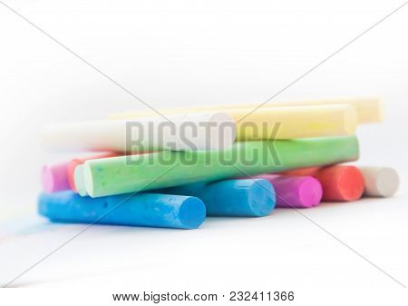 Chalk For Drawing Colorful On A White Background. Chalk In The Form Of Sticks Of Different Colors On