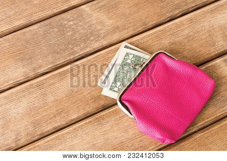 One Dollar Bills In My Wallet On A Wooden Table . On Wooden Background