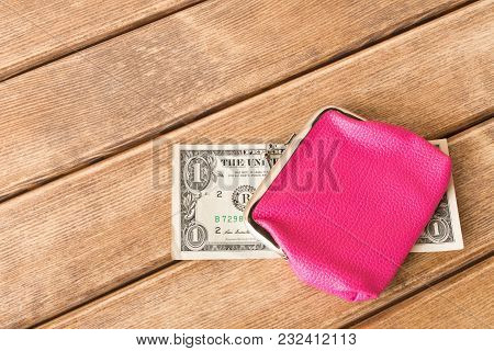 One Dollar Bills In My Wallet On A Wooden Table . On Wooden Background  .