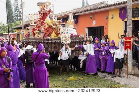 Antigua, Guatemala: March 18 2018: Woman In Front Of A Float With Mary, John And Jesus On Top At The