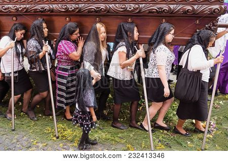 Antigua, Guatemala: March 18 2018: Women With Black Veils Walking Over Flower Carpet Andcarrying A F
