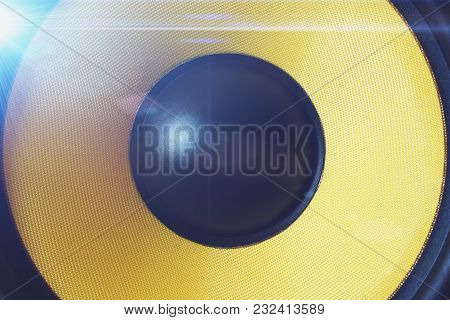 Yellow Subwoofer Dynamic Or Sound Speaker With Blue Light Effect, Music And Party Background