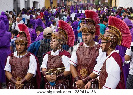 Antigua, Guatemala: March 18 2018: Four Men With Soldier Costumes Standing At The Procession Of San