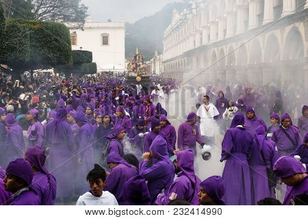 Antigua, Guatemala: March 18 2018: Priest In Incense Smoke In Front Of Float At The Procession San B