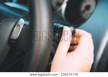 Closeup Women Driver Hand Operate The Lighting Multifunction Lever Inside Car  Vintage Color Tone