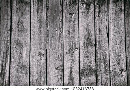Old Wooden Vertical Planks Texture With Scratches And Cracks. Wooden Background For Design