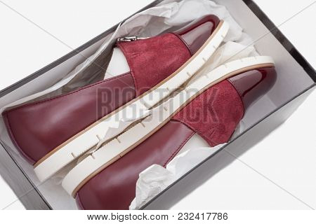 stylish, comfortable, red women shoes in box on a white background