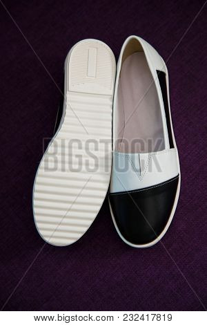 stylish, comfortable, two colored women shoes on a background