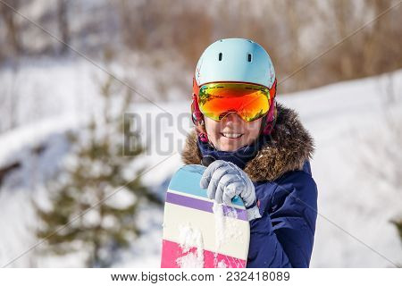 Photo Of Female Athlete In Mask And Helmet On Blurred Snowy Day Background