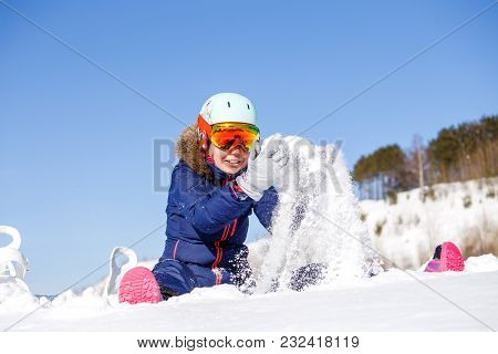 Picture Of Sports Woman Sitting In Snowdrift, Snow-throwing In Winter