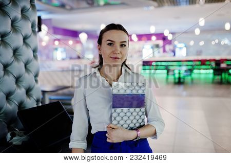 Waiter Girl Holding Menu At Cafe. People And Service Concept