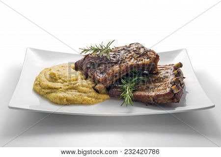 White Rectangular Plate With Baked Pork Ribs And Cornmeal Mush Isolated On White Background