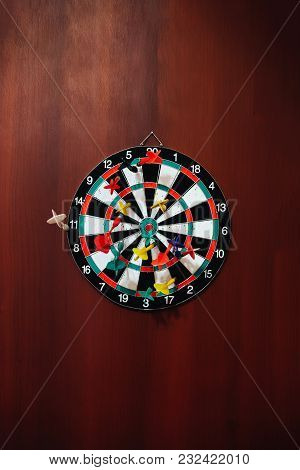 Darts Game With A Dart In The Target Colors