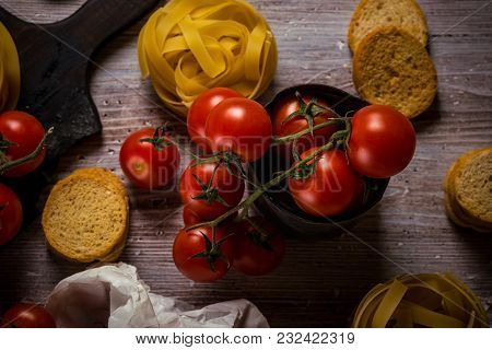 Top View On Small Cherry Tomatoes In Vintage Worn Can And Pasta Around