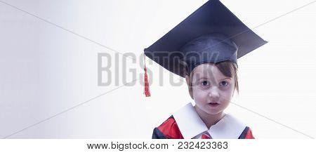Portrait Of Child Girl  Student Master. Humorous Photo. (knowledge, Studies, Work, Career Concept)