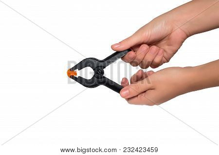 Different Color Plastic Clips In Hands Isolated On White Background. Teamwork, Collectivity, Leaders