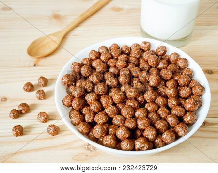 Chocolate Cereal Balls In A Bowl And A Glass Of Milk. Healthy Breakfast Concept. Top View.
