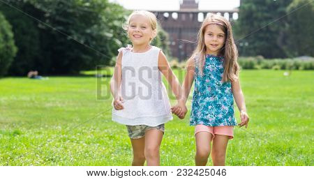 Children friends walking together outdoor