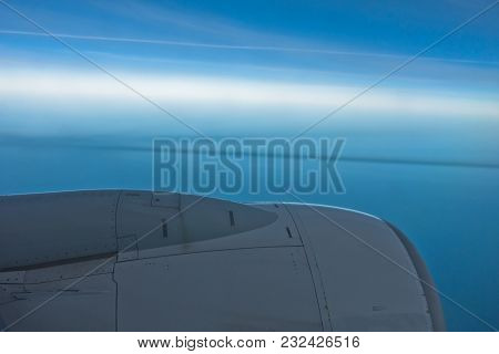 Airplane Engine With Clear Blue Sky Horizon In Background During Flight To Morocco