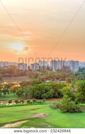 Aerial View Sun Setting Behind Park Lakeside Apartments In Singapore