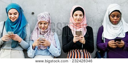 Muslim women hijab using smartphones