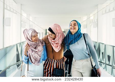 Muslim women talking with friends