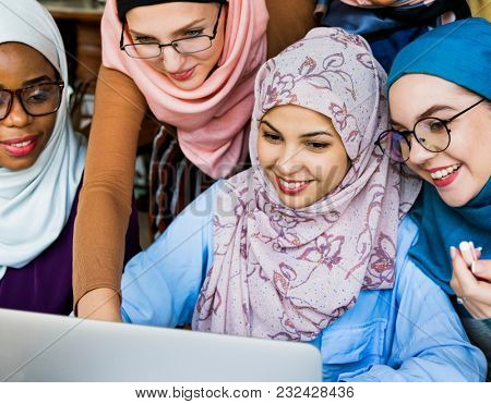 Islamic women working on computer