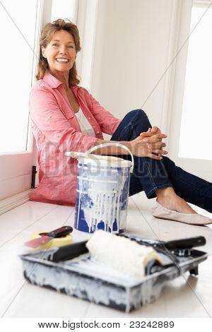 Senior woman decorating house