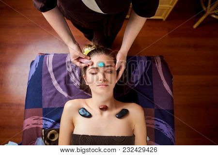 Stone Massage Is A Facial Massage For A Woman In The Beauty Center.