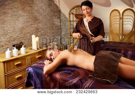 The Masseur Makes A Massage Massage With A Sticky Girl In The Spa Salon.