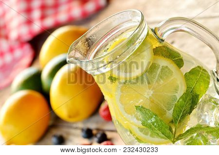 Detail Of Fresh Lemon-lime Water With Mint And Ice In A Glass Carafe And Strawberries, Blueberries A